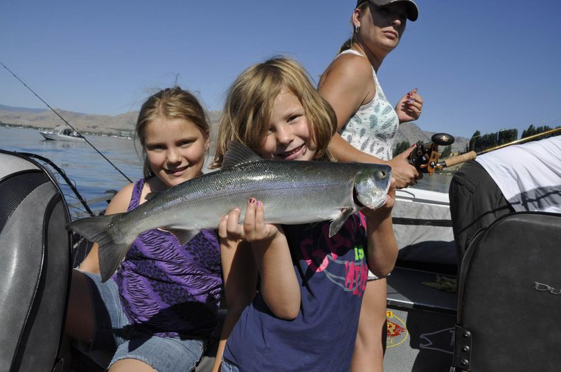 Katlynn, 6, holds a sockeye caught by her sister Mckayla, 10, on a family fishing trip with their father, Omak guide Jerrod Gibbons on the Columbia River near Brewster on July 1, 2015. RICH LANDERS richl@spokesman.com (Rich Landers / The Spokesman-Review)