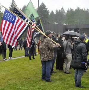 OLYMPIA -- Members of the Patriot Prayer protest group carried a wide variety of flags at their demonstration Thursday on The Evergreen State College campus.  (Jim Camden/The Spokesman-Review)