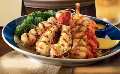 Pictured is Red Lobster's Wood-Grilled Lobster, Shrimp and Scallops dish. Courtesy of Red Lobster (Courtesy of Red Lobster / The Spokesman-Review)