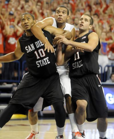 Gonzaga's Elias Harris is blocked out on a rebound by San Diego State's Tim Shelton, left, and James Rahon in Tuesday night's game in which Harris injured his Achilles tendon.  (Jesse Tinsley / The Spokesman-Review)