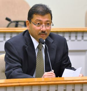OLYMPIA -- Dr. Arun Raha, state chief economist, reads from his list of Top 10 Arun-isms at a press conference announcing he is resigning to take a job in Cleveland. (Jim Camden)