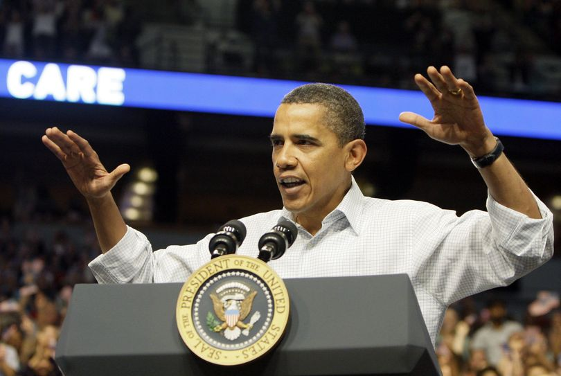 President Barack Obama gestures while addressing a health insurance reform rally Saturday in Minneapolis.  (Associated Press / The Spokesman-Review)