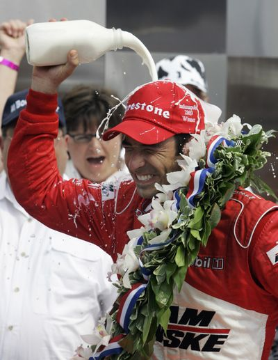 Associated Press Helio Castroneves douses himself with milk after winning the Indianapolis 500 on Sunday. (Associated Press / The Spokesman-Review)