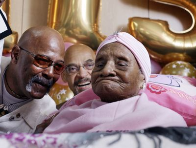 Gertrude Baines, far right,  celebrates her 115th birthday Monday in Los Angeles. She was born in Shellman, Ga. (Associated Press / The Spokesman-Review)