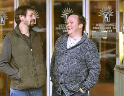 Gordon Mellot, right, and husband Rob Rhodes share a laugh in front of the Kenworthy Theater in Moscow, Idaho, on Nov. 4, 2017. (Kai Eiselein / Moscow-Pullman Daily News)
