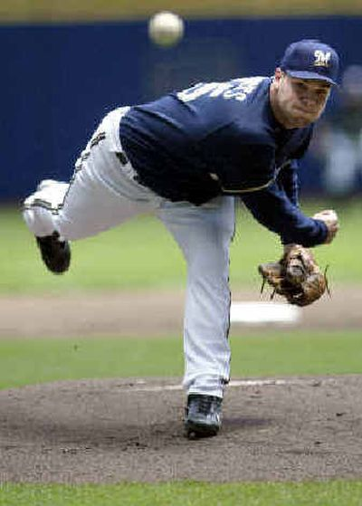 Milwaukee's Ben Sheets delivers a pitch during the first inning against the Atlanta Braves on Sunday. Milwaukee's Ben Sheets delivers a pitch during the first inning against the Atlanta Braves on Sunday.   (Associated PressAssociated Press / The Spokesman-Review)