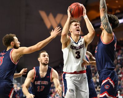 Forward Filip Petrusev battles inside against Saint Mary's defenders during Gonzaga's 84-66 win in the 2020 WCC Tournament championship game at Orleans Arena in Las Vegas.  (Tyler Tjomsland/The Spokesman-Review)