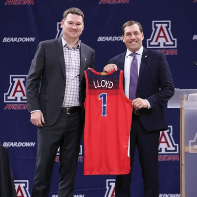 New Arizona coach Tommy Lloyd (left) and athletic director Dave Heeke pose during Lloyd's introductory news conference.  (Courtesy Arizona athletics)