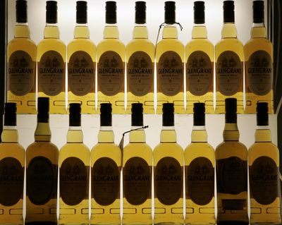 Scotch bottles are displayed in Cologne, Germany, in 2009.  (Associated Press)