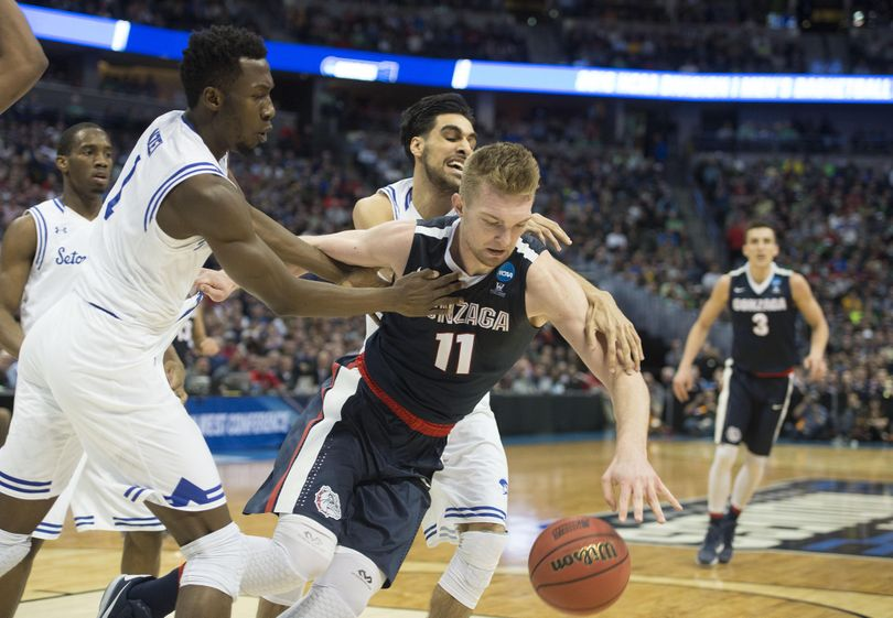 Gonzaga's Domantas Sabonis is harassed by the Seton Hall defense during the first half, March 17, 2016, at the Pepsi Center in Denver. (Dan Pelle / The Spokesman-Review)