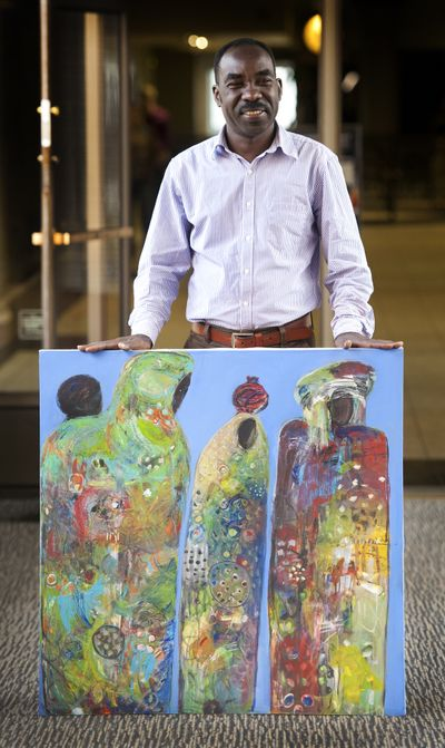 Adam Henawy, from Sudan, creates art that reflects the Sudanese culture, Darfur folklore and the ongoing conflict of the region. (Dan Pelle)