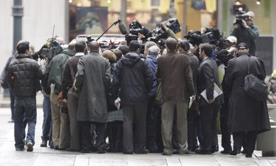 Rod Blagojevich is surrounded by media Tuesday while leaving federal court in Chicago.  (Associated Press / The Spokesman-Review)