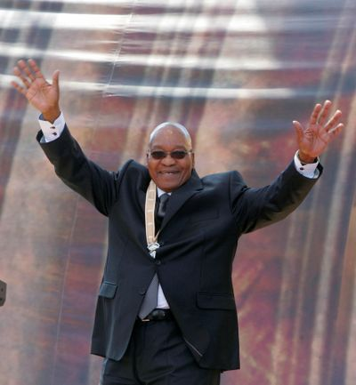 South African President Jacob Zuma, 67, waves to supporters after his swearing-in ceremony in Pretoria on Saturday.  (Associated Press / The Spokesman-Review)
