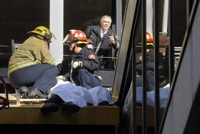 Spokane Fire Department personnel secure the body of a man who fell from the west side of the Parkade in Spokane on Wednesday.  (CHRISTOPHER ANDERSON / The Spokesman-Review)