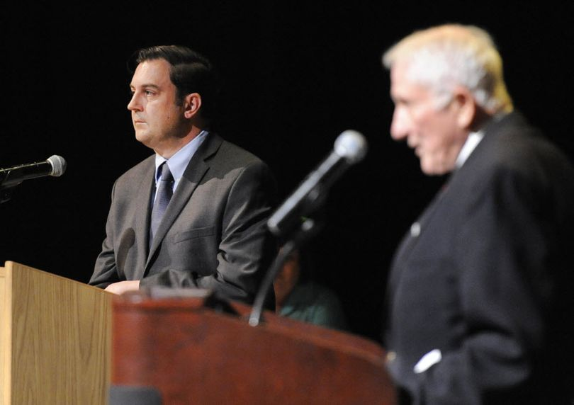City Council president candidates Ben Stuckart, left, and John Ahern, right, debate at the candidate debates held by the Chase Youth Commission Wednesday, Oct. 7, 2015 at North Central High School. (Jesse Tinsley / The Spokesman-Review)