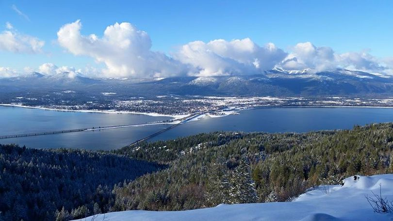 Hikers get a wintry view of Sandpoint and the source of the Pend Oreille River from Gold Hill on Dec. 16, 2015, after a storm dropped several inches of new snow. (Sandii Mellen)
