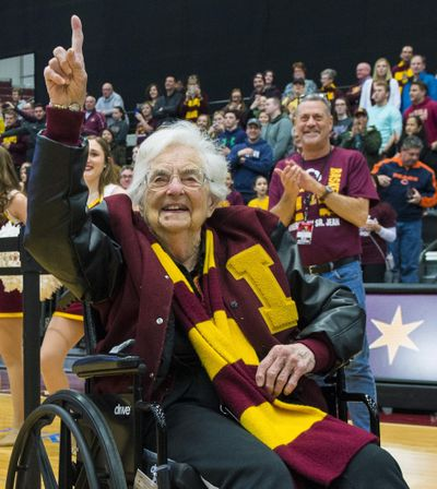 In this March 25, 2018, file photo, Sister Jean Dolores-Schmidt, chaplain of the Loyola-Chicago basketball team, gestures during a rally for the team in Chicago. Sister Jean is celebrating her 99th birthday months after gaining national attention as chaplain of the team that reached the NCAA Final Four. The university held a campus party with students and school staffers Tuesday, Aug. 21, 2018. (Tyler LaRiviere / Chicago Sun-Times via AP)