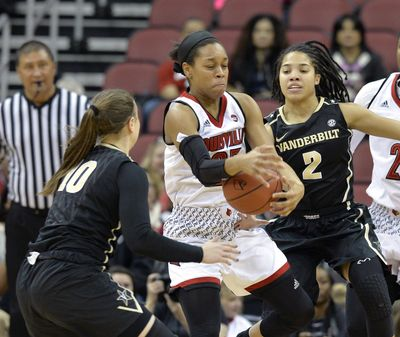Louisville guard Asia Durr (25) grabs the ball between the defense of Vanderbilt guard Cierra Walker (10) and Chelsie Hall during the first half of an NCAA college basketball game, Thursday, Dec. 7, 2017, in Louisville, Ky. (Timothy D. Easley / Associated Press)
