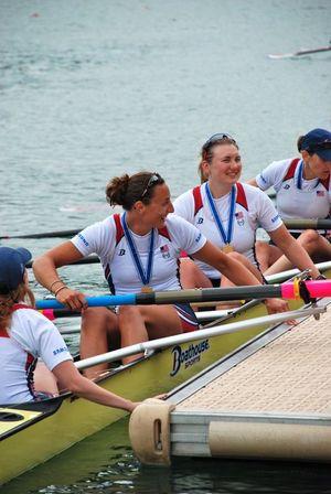 Jamie Redman of Spokane, second from top, sits in her U.S. Rowing Team's Women's 8 boat wearing her gold medal after winning Switzerland's World Cup Regatta on July 10, 2011. (U.S. Rowing)
