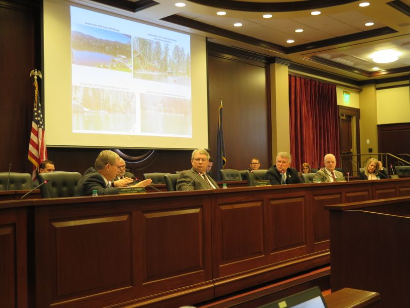 From left, Idaho Attorney General Lawrence Wasden, Secretary of State Lawrence Denney, Gov. Butch Otter, state Controller Brandon Woolf, and state schools Superintendent Sherri Ybarra, meeting as the state Land Board on Tuesday, Nov. 21, 2017, discuss boat wakes and illegal buoys on the Spokane River in North Idaho. (Betsy Z. Russell)