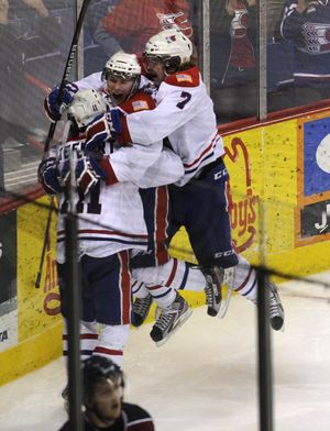 Spokane Chiefs Liam Stewart, left, celebrates his overtime game winning goal with Connor Chartier and Tyler King Monday night in the Spokane Arena. COLIN MULVANY (Colin Mulvany / The Spokesman-Review)