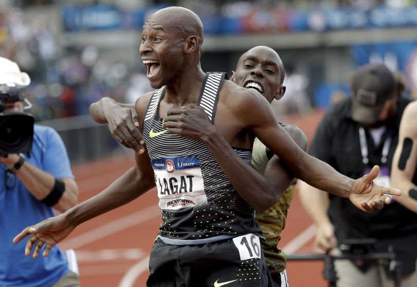 Bernard Lagat, left, celebrates his win in the finals of the men's 5000-meter run with Paul Chelimo at the U.S. Olympic Track and Field Trials on Saturday. (Associated Press)