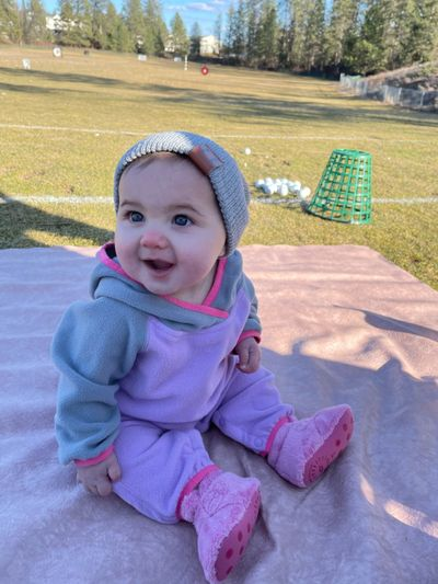 Quinnley McCord, the 9-month-old daughter of the author, is clearly enjoying herself - at least for the time being - during a March 11, 2021, trip to the driving range at Indian Canyon Golf Course.  (Courtesy of Jordyn McCord)