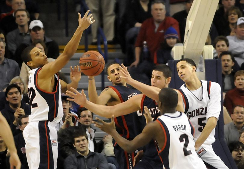 (Left to right) Gonzaga's Steven Gray, Saint Mary's Diamon Simpson and Omar Samhan and GU's Jeremy Pargo and Austin Daye battle for a rebound. (Jesse Tinsley / The Spokesman-Review)