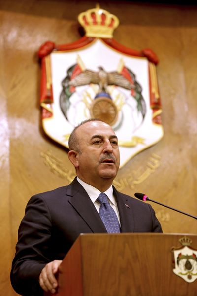 Turkish Foreign Minister Mevlut Cavusoglu, and Jordanian Foreign Minister Ayman Safadi, give a press conference in Amman, Jordan, Monday, Feb. 19, 2018. (Raad Adayleh / Associated Press)