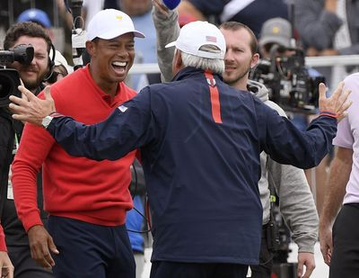 U.S. team player and captain Tiger Woods, left, celebrates with vice captain Fred Couples after Woods won his singles match during the Presidents Cup golf tournament at Royal Melbourne Golf Club in Melbourne, Sunday, Dec. 15, 2019. (Andy Brownbill / AP)