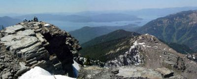 With Lake Pend Oreille sprawling in the background to the south, a group of hikers takes a break on top of 7,009-foot Scotchman Peak, the highest point in Bonner County.   (The Spokesman-Review)