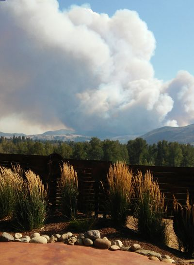 Okanogan County officials are evacuating the entire cities of Twisp and Winthrop because of fast-moving wildfires.