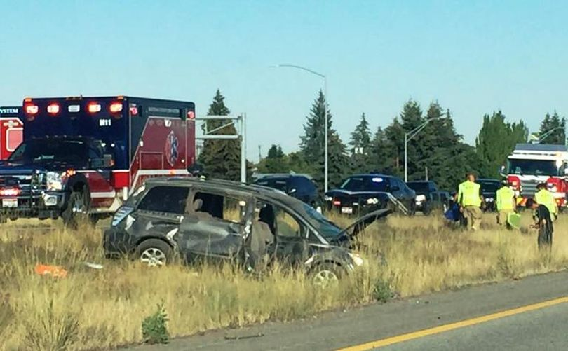 Photographer Eric Barro, editor-in-chief of WTFashion, snapped this picture en route to work today. Eric reports that the crash of the westbound vehicle took place around I-90/Highway 41. It tied up traffic, both ways on the freeway, immediately.