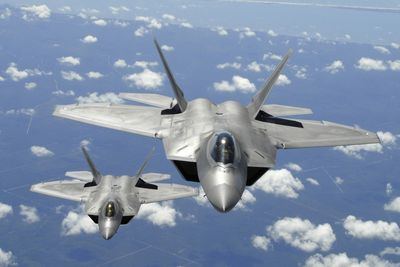 Defense Secretary Robert Gates on Monday proposed ending the F-22 fighter jet program due to its high cost.  (Associated Press / The Spokesman-Review)