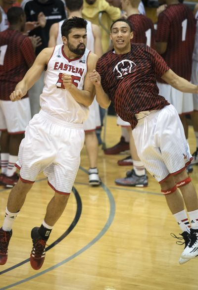 Eastern Washington forward Venky Jois (55) and Eastern Washington guard Tyler Harvey, right, bump shoulders during player introductions, Feb. 12, 2015, on Reese Court in Cheney, Wash. (Colin Mulvany / The Spokesman-Review)