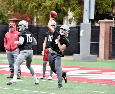 Washington State freshman Jayden de Laura uncorks a pass during the team's second practice during preseason camp.  (Washington State Athletics )