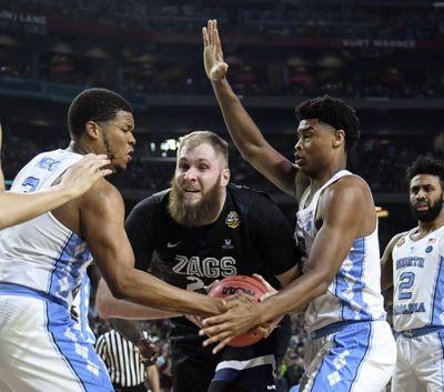 Gonzaga center Przemek Karnowski is pressured by North Carolina forward Kennedy Meeks, left, and Isaiah Hicks. (Dan Pelle / The Spokesman-Review)