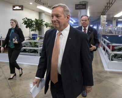 Sen. Dick Durbin, D-Ill., followed by Sen. Bob Menendez, D-N.J., walks to the Senate as Congress moves closer to the funding deadline to avoid a government shutdown, at the Capitol in Washington, Thursday, Jan. 18, 2018. (J. Scott Applewhite / Associated Press)