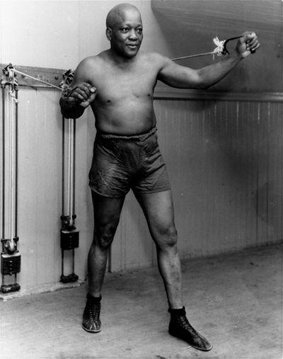 In this 1932 file photo, boxer Jack Johnson, the first black world heavyweight champion, poses in New York City. (Associated Press)