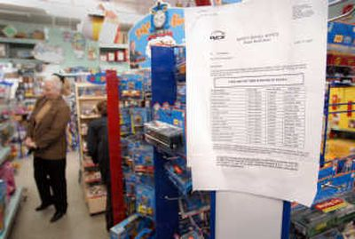 A list of recalled models of Thomas the Tank Engine toys is taped to the display at the White Elephant store in Spokane on Friday.    (Jesse Tinsley / The Spokesman-Review)