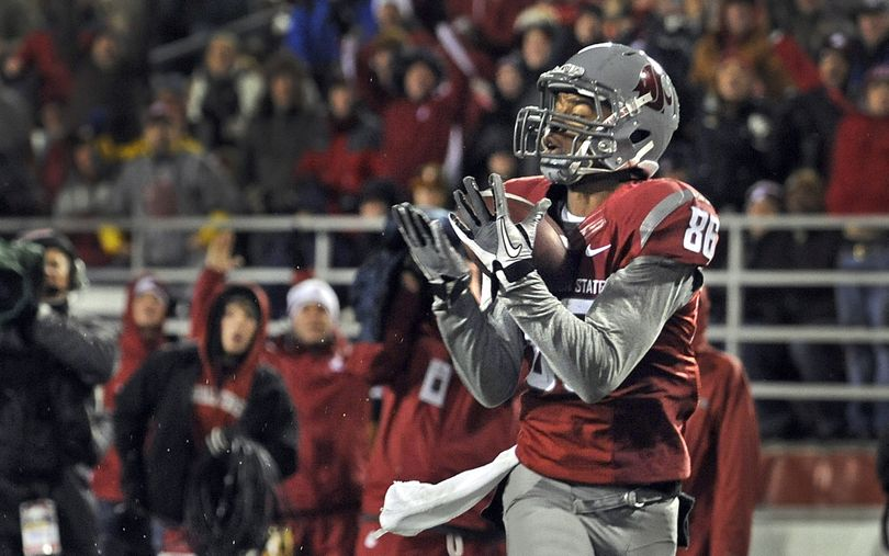 WSU wide receiver Marquess Wilson cradles his second touchdown pass during first half action against Arizona State in their game in Pullman, Saturday, Nov. 12, 2011. (Christopher Anderson / Spokesman-Review)