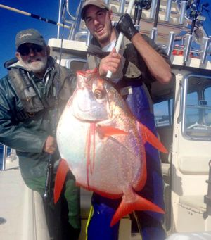 Pending Washington state-record moonfish caught out of Westport on Sept. 27, 2015, weighs 36 pounds. At left is angler Jim Watson of Coeur d'Alene and deckhand Joel Torrison of All Rivers & Saltwater Charters.   (Courtesy)