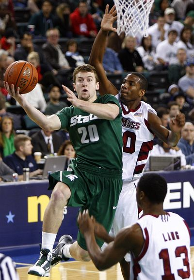 Michigan State's Mike Kebler goes to the net with Massachusetts' Javorn Farrell on his heels during the Spartans' 106-68 win. (Associated Press)