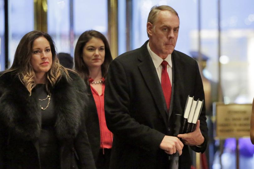 Rep. Ryan Zinke, right, R-Mont., arrives in Trump Tower, in New York, Monday, Dec. 12, 2016. (Richard Drew / Associated Press)