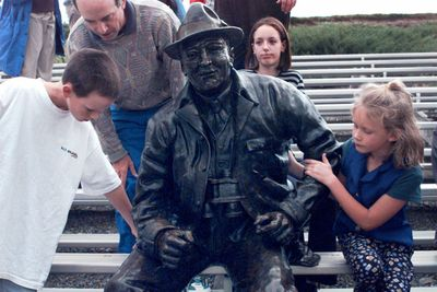 When the statue of Joe Fan was unveiled at Albi Stadium in 1997, Bill Albi, left, and his sister, Sarah, were there to check it out. Artist Vincent DeFelice used their ancestor, Joe Albi, as the model for the tribute to fans and the stadium.  (File / The Spokesman-Review)