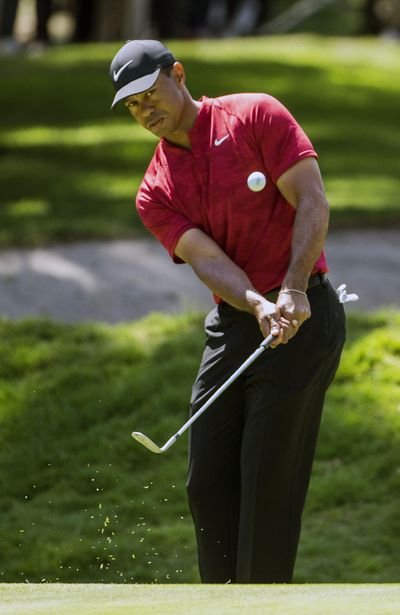 In this Feb. 24, 2019 photo, Tiger Woods hits the ball on the first hole during the WGC-Mexico Championship at the Chapultepec Golf Club in Mexico City. Woods has withdrawn from the Arnold Palmer Invitational with what he describes as a neck strain. Woods announced his decision Monday. March 4, 2019, on Twitter. (Associated Press)