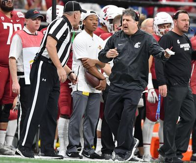 Washington State Cougars head coach Mike Leach speaks with an official during the first half of the 2018 Alamo Bowl on Friday, December 28, 2018, at the Alamo Dome in San Antonio, TX. (Tyler Tjomsland / The Spokesman-Review)