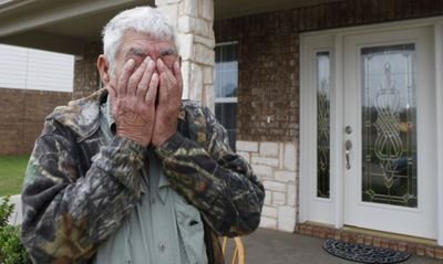 Wilburn C. Russell wipes his eyes after talking to reporters Tuesday in front of the house his son, U.S. Army Sgt. John Russell, in Sherman, Texas.  (Associated Press / The Spokesman-Review)