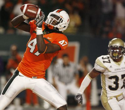 Miami's LaRon Byrd hauls in a first-quarter pass Thursday.  (Associated Press / The Spokesman-Review)