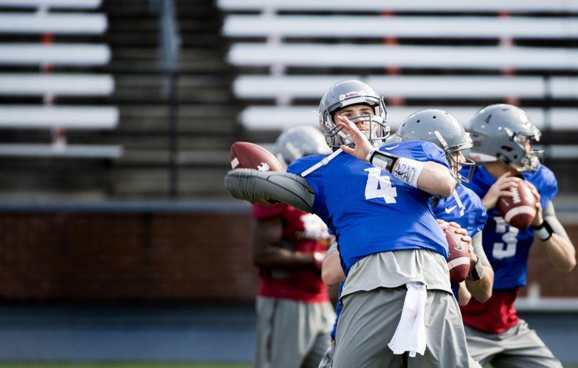 WSU quarterback Luke Falk throws the ball during practice on Thursday, March 31, 2016, at Martin Stadium in Pullman, Wash. (Tyler Tjomsland / The Spokesman-Review)